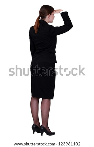 businesswoman seen from behind looking in the distance - stock photo