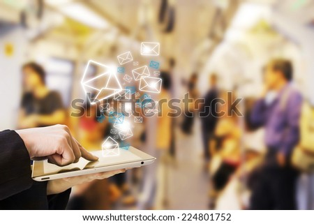 Businesswoman sending email in skytrain - stock photo