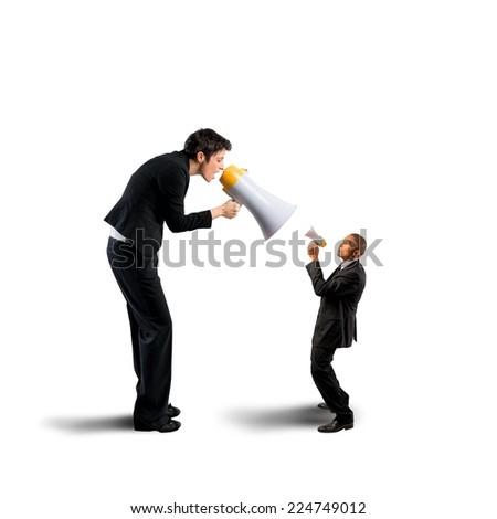 Businesswoman shouting a businessman through a megaphone - stock photo