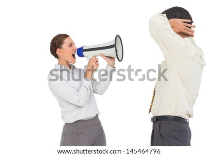 Businesswoman shouting at businessman with megaphone on white background