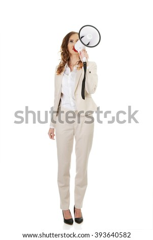 Businesswoman shouting with megaphone. - stock photo