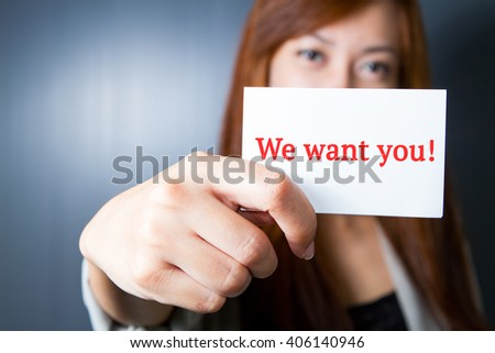 "Businesswoman show message ""We want you!"" on the card."