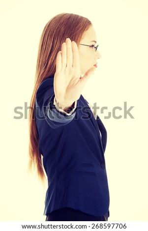 Businesswoman show NO gesture with confident expression. - stock photo