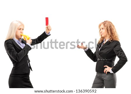 Businesswoman showing a red card to another businesswoman, isolated on white background - stock photo