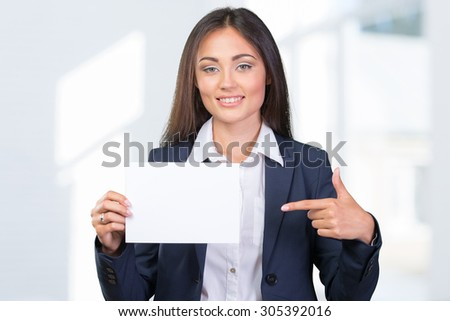 Businesswoman showing blank card - stock photo