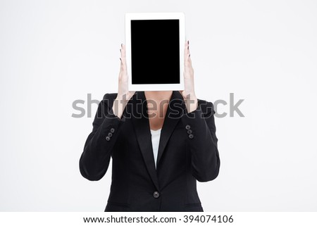 Businesswoman showing blank tablet computer screen isolated on a white background - stock photo
