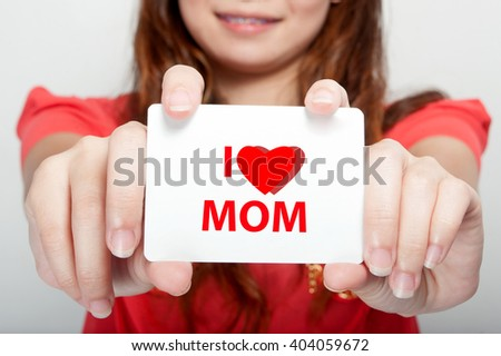 Businesswoman showing card with i love mom message, - stock photo