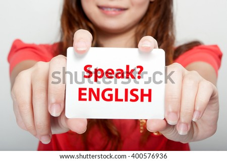 Businesswoman showing card with speak? englesh message, - stock photo