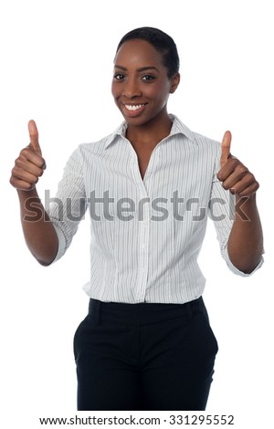 Businesswoman showing double thumbs up - stock photo