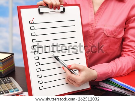 businesswoman showing drawing  application form on clipboard - stock photo