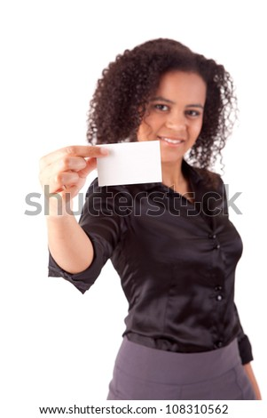 Businesswoman showing greeting card - selective focus on hand