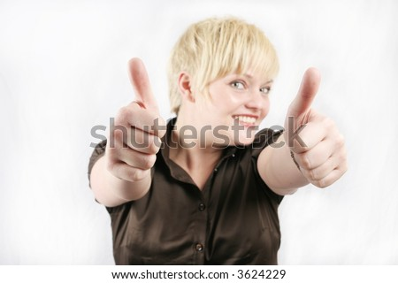 Businesswoman showing thumbs up - stock photo