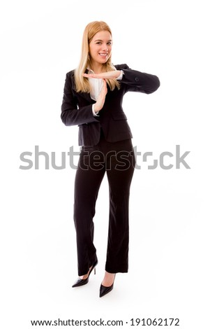 Businesswoman showing timeout gesture