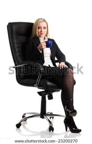 Businesswoman sits on a chair with a cup on a white background - stock photo