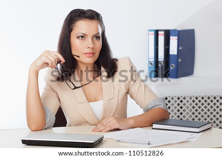 businesswoman sitting at workplace and thinking - stock photo