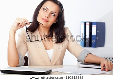 businesswoman sitting at workplace and thinking