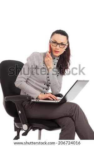 businesswoman sitting in the office chair with laptop talking on the phone over white background  - stock photo