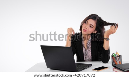 Businesswoman sitting on her working desk, imagining and looking at her side, copyspace on white background - stock photo