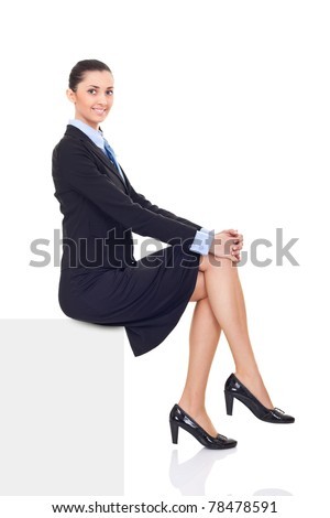 businesswoman sitting on horizontal banner edge,  smiling woman showing sign with lot of copy space, isolated on white background in full body - stock photo