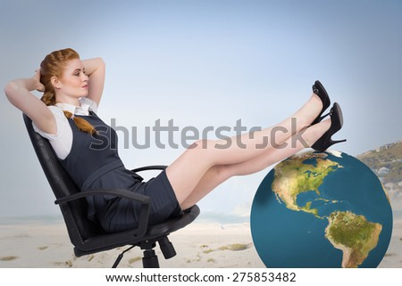 Businesswoman sitting on swivel chair against beautiful beach and blue sky - stock photo