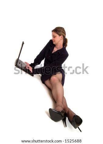 Businesswoman sitting on the floor using a laptop computer