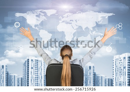 Businesswoman sitting with her hands outstretched against urban background with world map above and other virtual elements - stock photo