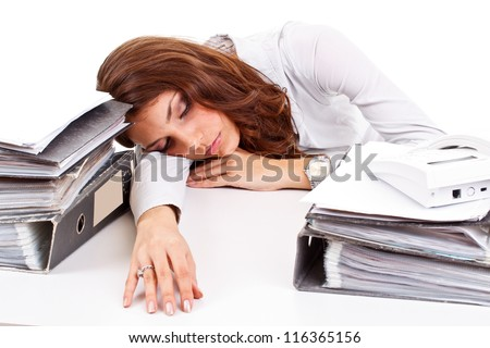 Businesswoman sleeping on working place - stock photo