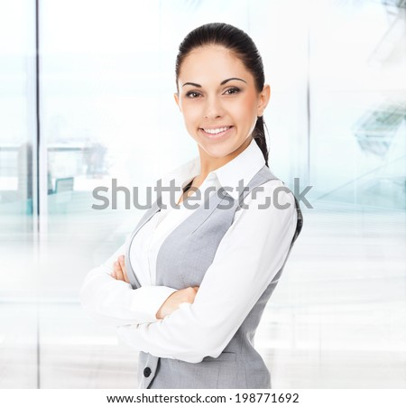 Businesswoman smile, folded hands, young attractive business woman in modern office - stock photo