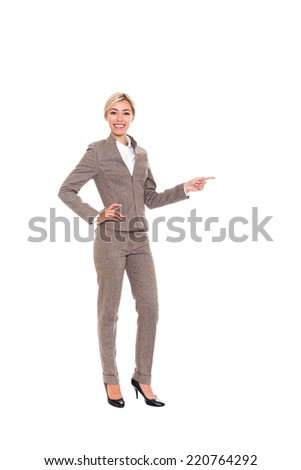 Businesswoman smile point finger to empty copy space, business woman showing pointing side, concept of advertisement product. Full length portrait isolated over white background - stock photo