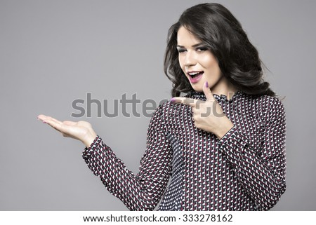 Businesswoman smile point finger to empty copy space, business woman showing pointing side, concept of advertisement product. - stock photo