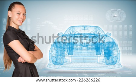 Businesswoman smiling and standing with crossed arms. Glow wire-frame car on transparent plane - stock photo