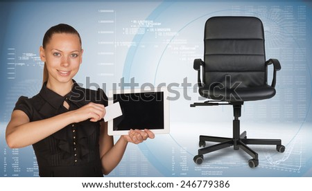 Businesswoman smiling holding blank tablet PC and blank business card in front of PC screen. Office chair beside. Hi-tech graphs with various data as backdrop - stock photo