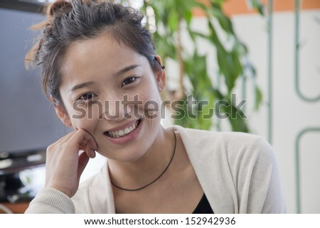 Businesswoman smiling in the office, portrait - stock photo