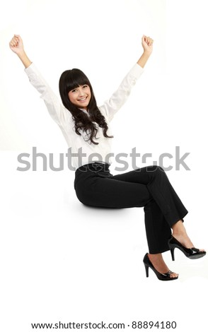 Businesswoman smiling sitting on blank empty billboard sign. isolated on white background. - stock photo