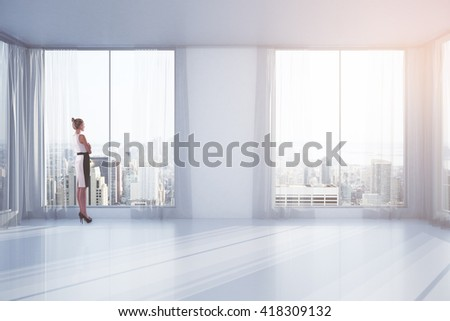Businesswoman standing in empty interior with curtains and windows with New York city view. 3D Rendering - stock photo