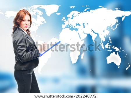 businesswoman   standing in front of an earth map  - stock photo