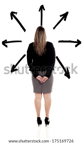 Businesswoman standing in front of black arrows to pick a direction to take. Making a decision. - stock photo