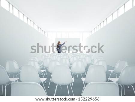 Businesswoman standing in meeting room