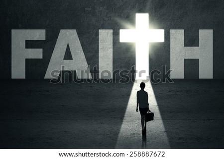 Businesswoman standing in the faith door - stock photo