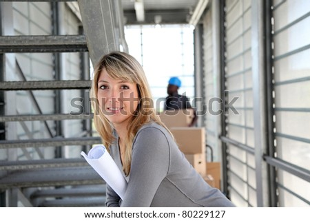 Businesswoman standing in warehouse