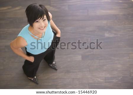Businesswoman standing indoors smiling - stock photo