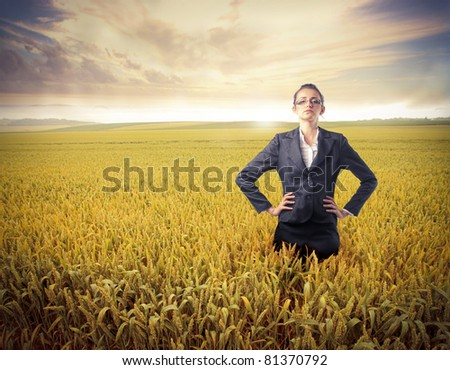 Businesswoman standing on a wheat field