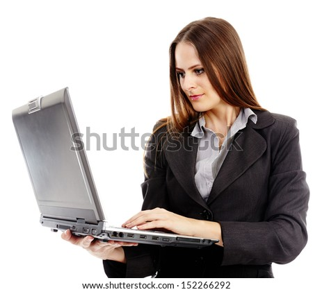 Businesswoman standing with her laptop isolated on a white background