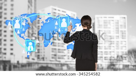 Businesswoman stands near map with icons on the city background. Elements of this image furnished by NASA - stock photo