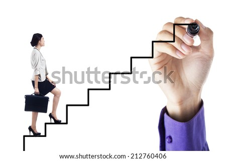 Businesswoman stepping up on stairs to gain her success with a hand drawing the stairs - stock photo
