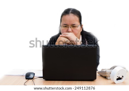 businesswoman strain worried business woman sitting in front of laptop computer  - stock photo