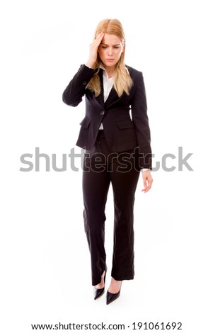 Businesswoman suffering from headache - stock photo