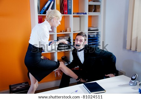 Businesswoman taking control over the manager. - stock photo