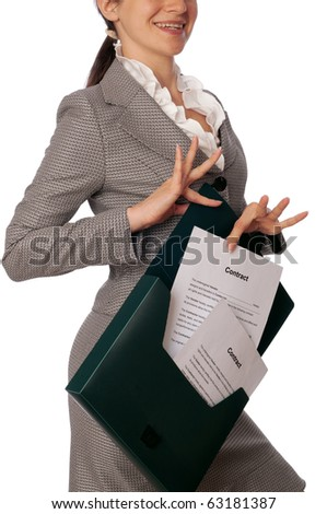 Businesswoman taking out from a suitcase contract for new employees - stock photo