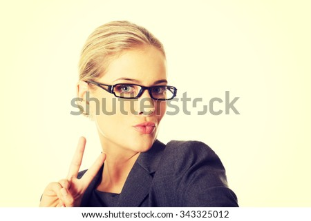 Businesswoman taking selfie with smartphone - stock photo